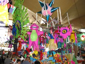 Market stall at the Coyoacan market that sold fruit and pinatas