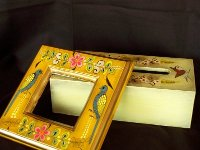Hand-painted wooden frame and tissue box cover. Both 1960s.
