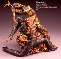 Flamenco - At only 14 inches tall, my bronze foundry thought it was a cast bronze when I took it in for a mould estimate!  It is printed newsprint papier mache with an aluminum foil armature. I shaped, dried, carved and shaped some more for the detail. The finish is acrylic metallics tinted with coloured metallics to highlight the colour for a natural patina look.  Red to copper and bronze metallic for the male and hansa yellow to the gold in the womans dress.