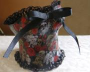 Skulls and roses papier mache corset by Sara Hall